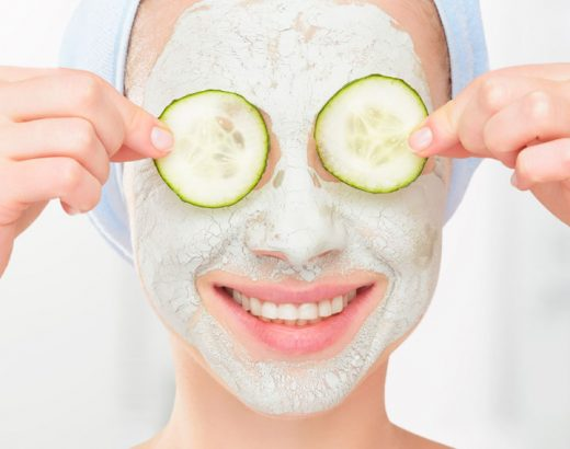 Girl using cucumber face mask