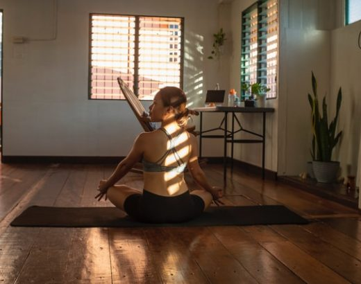 Woman practicing yoga in her home