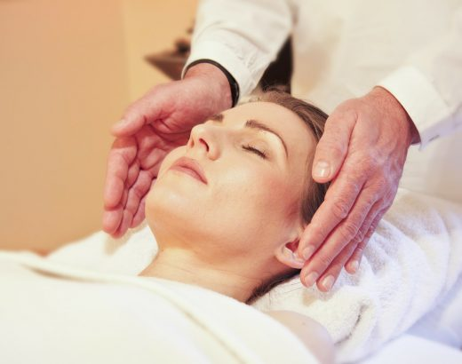 Woman receiving a facial massage