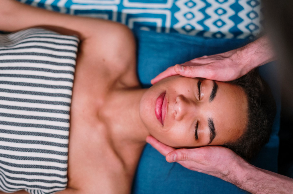 Woman relaxing and receiving a facial massage
